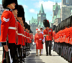 Queen Elizabeth II inspects a Guard of Honour outside the Canadian Parliament, after arriving to attend the Canada Day celebrations, in Ottawa, Canada.